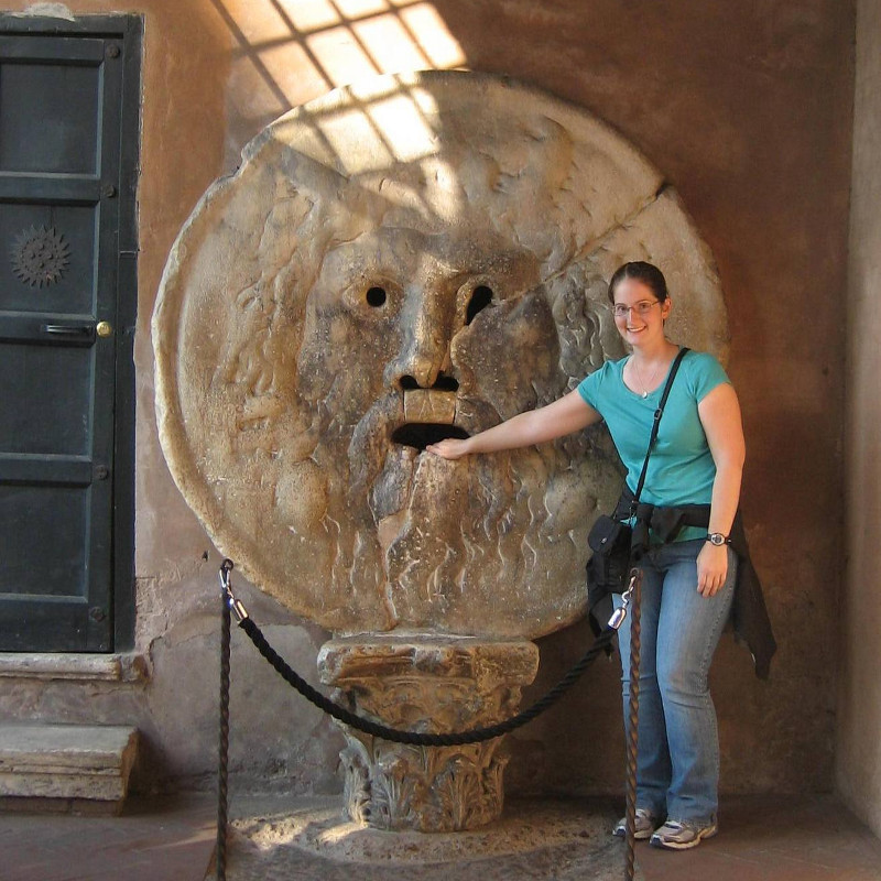 Katie with her hand in La Bocca della Verità (The Mouth of Truth) in Rome, Italy (copyright Kathryn Watt)