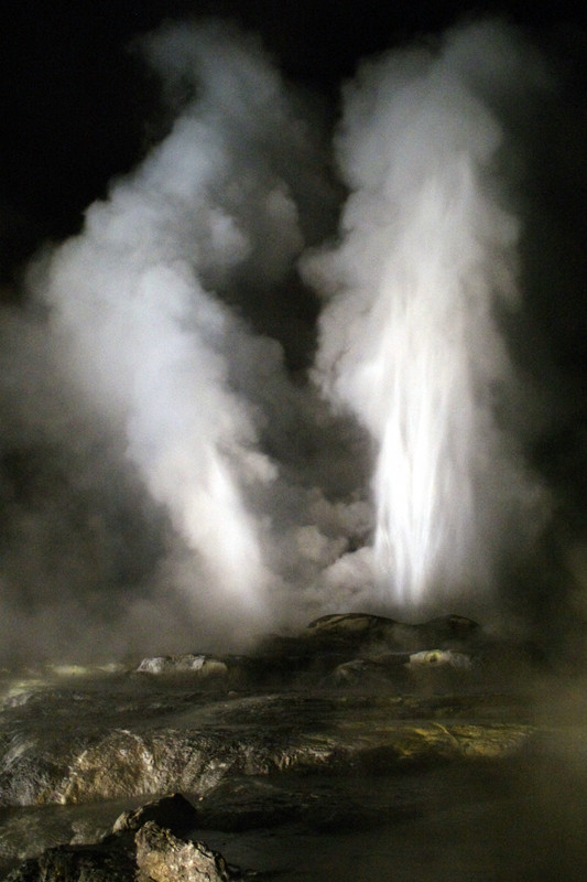 Pohutu Geyser erupting at night