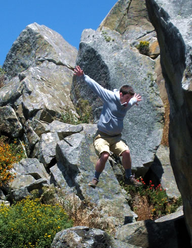 Justin jumps off a rock at Salt Point State Park
