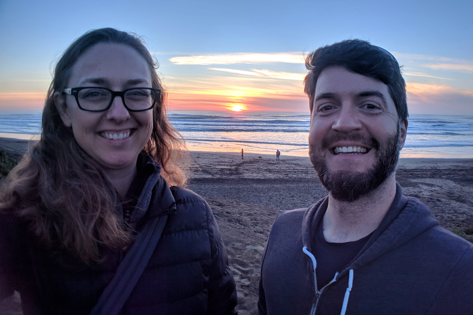 Stephanie and Justin on Ocean Beach in San Francisco, CA at sunset on January 31, 2019