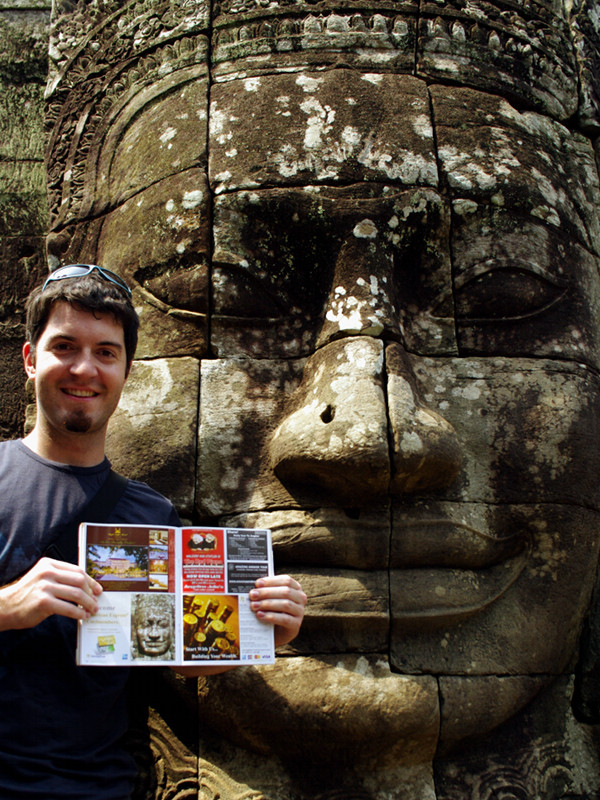 Justin posing with a smiling face in the Bayon temple at Angkor Thom with the magazine showing the same face from 2003