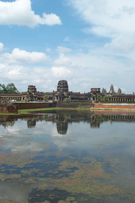 View of Angkor Wat temple complex reflected in its 190 meter wide moat
