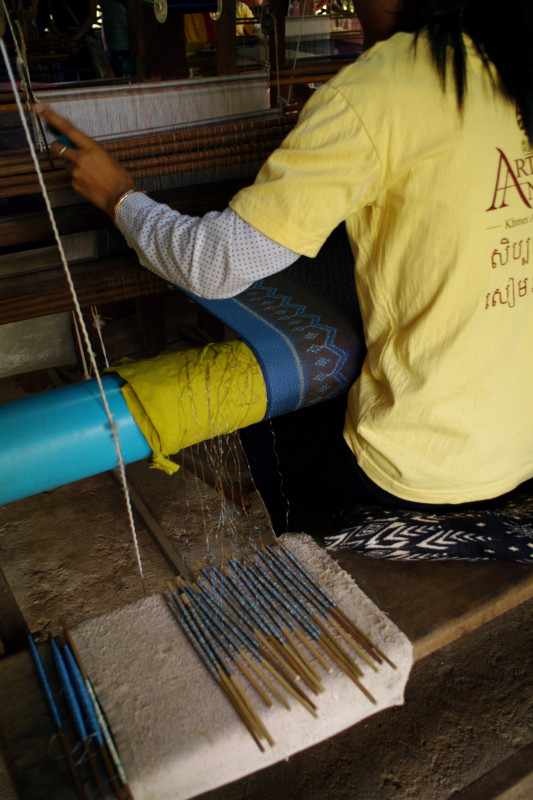 Creating a patterned silk scarf (or krama) on the loom in Siem Reap Cambodia