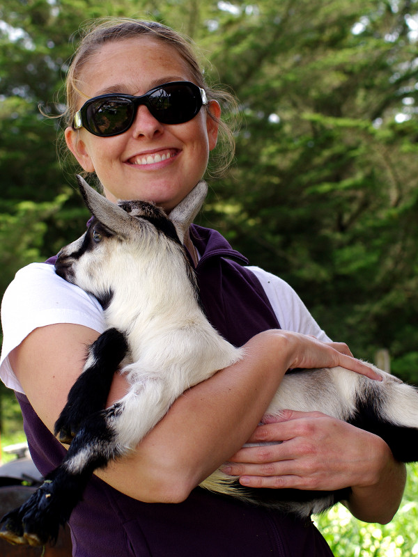 Stephanie holding a baby goat