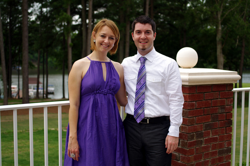 Stephanie in a purple dress, and Justin with a purple tie, at Patrick and Laura's wedding