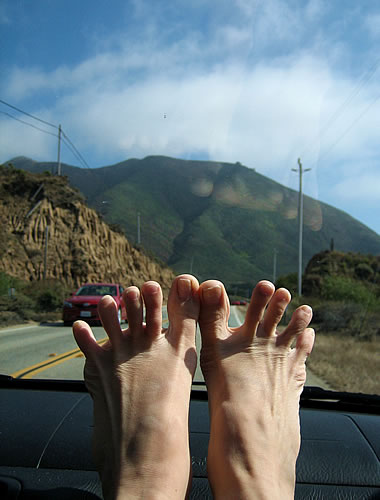 Stephanie's toes on the dashboard, CA-1 in the background