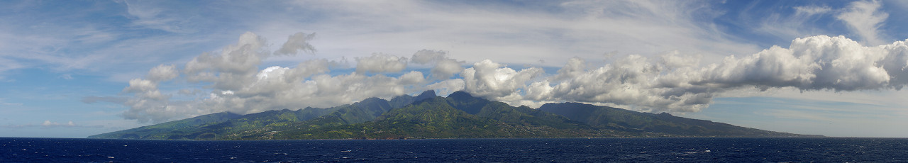 Approaching the island of Tahiti by container ship panorama