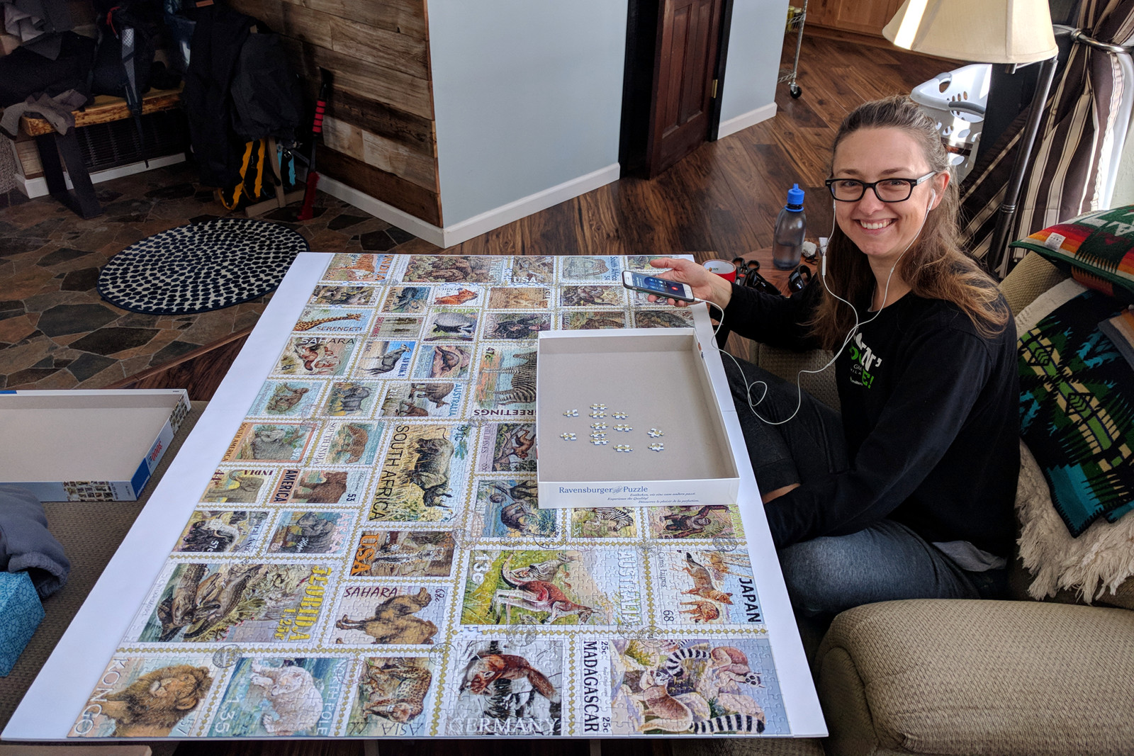 Stephanie almost done with the 3000-piece Animal Stamps jigsaw puzzle by Ravensburger