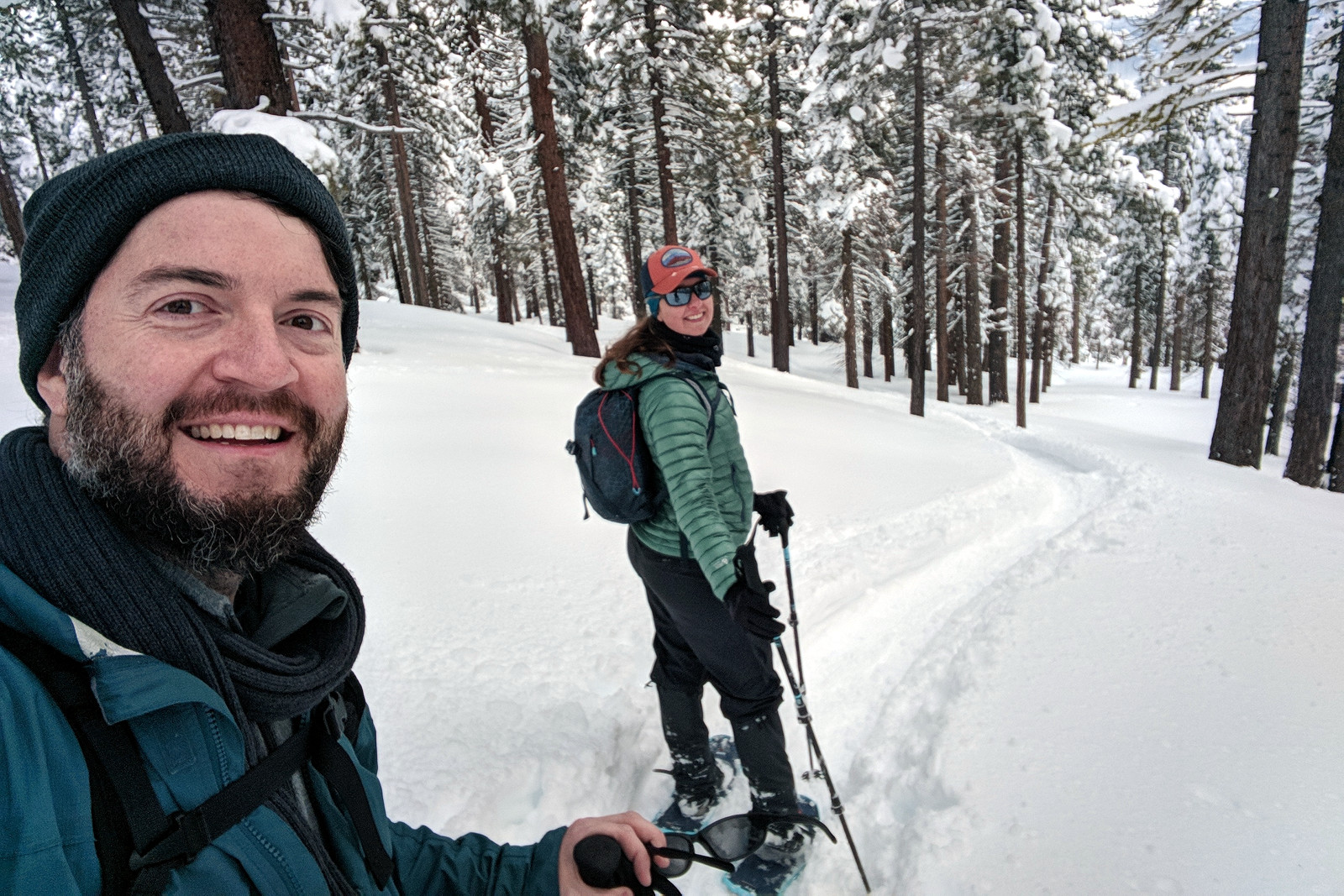 Justin and Stephanie snowshoeing down from Picnic Rock at Lake Tahoe, California