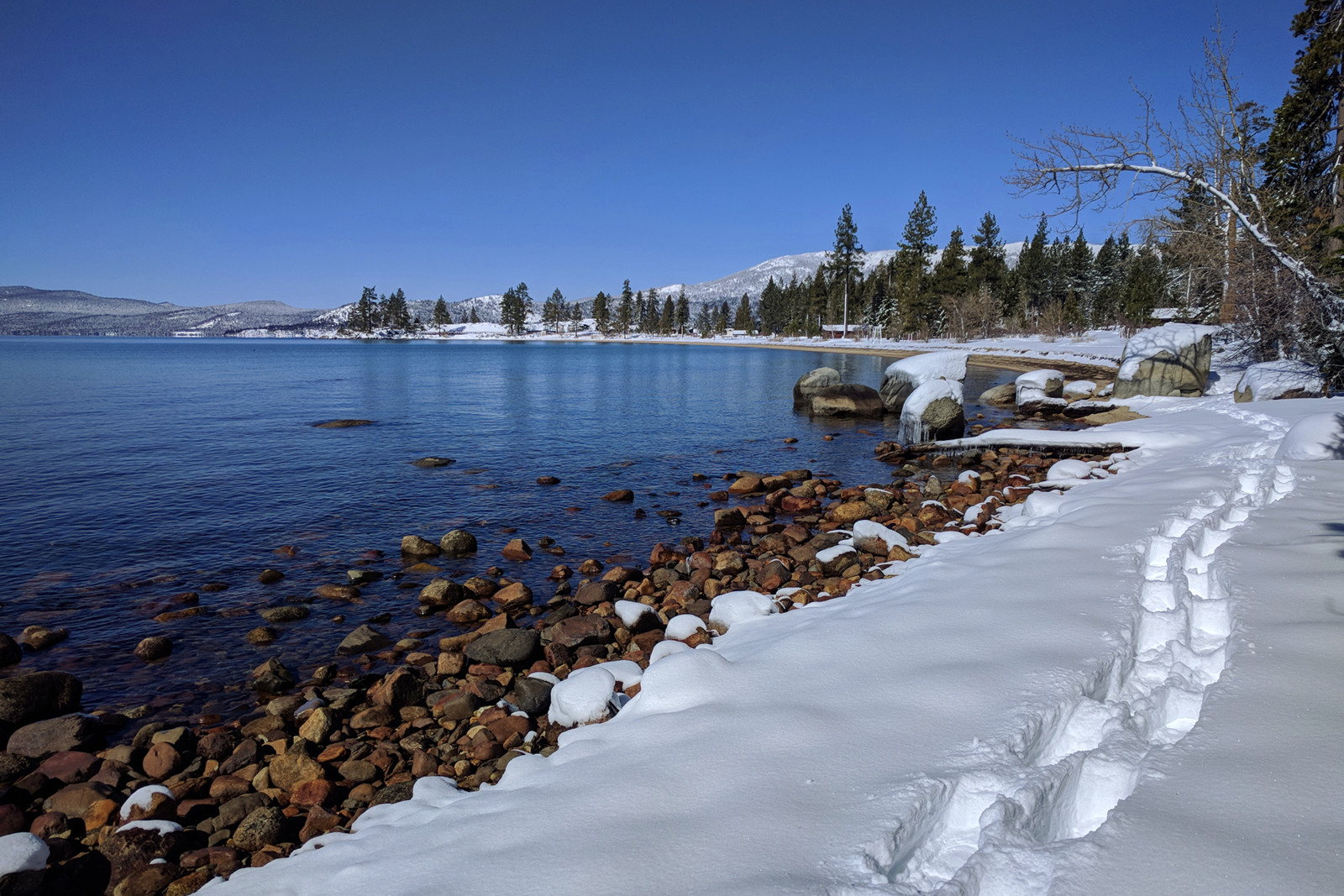 Snowshoe tracks along the lake around Lake Tahoe, California