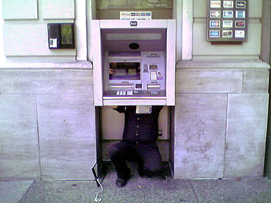 There's a man in the ATM