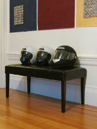 Three helmets on a bench