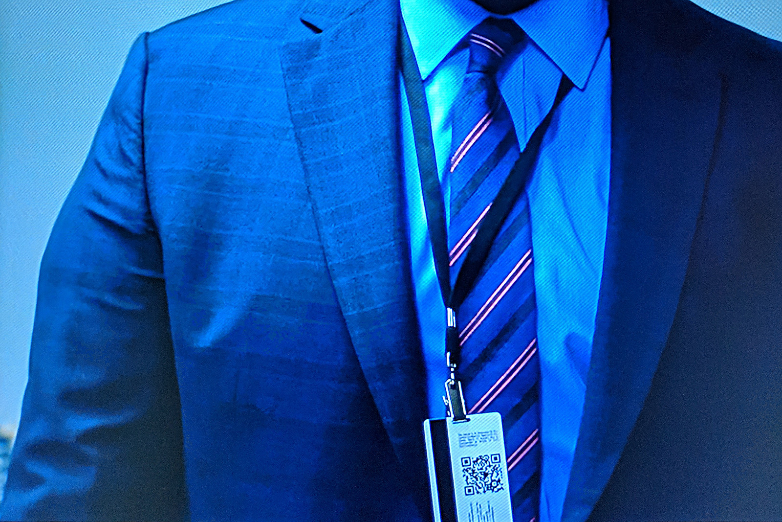 Screenshot from episode 1 of Tom Clancy's Jack Ryan, showing justinsomnia.org QR Code on James Greer's badge, close-up