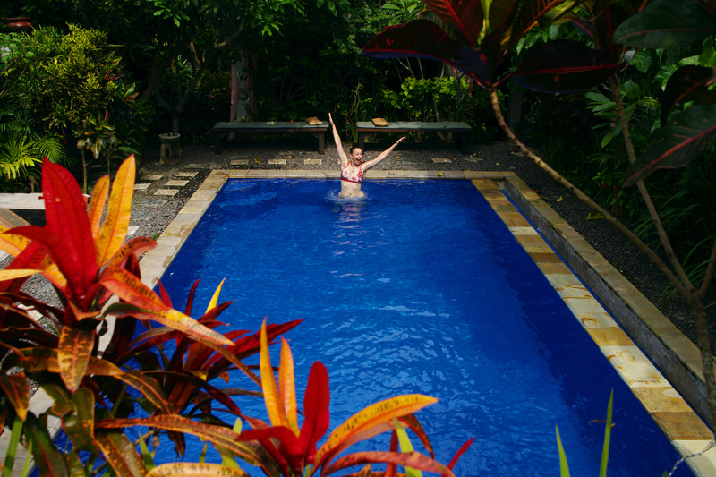 Stephanie jumping in the pool at the Tropical Bali Hotel