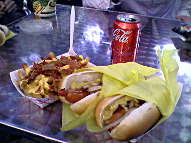 Two 'What's Up Dogs', bacon cheese fries, and a coke