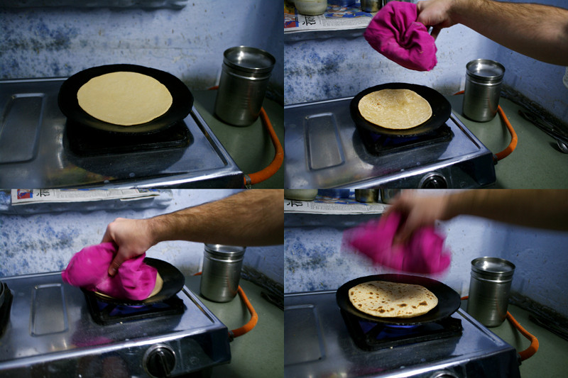 Several stages showing how to cook a chapati on a tawa