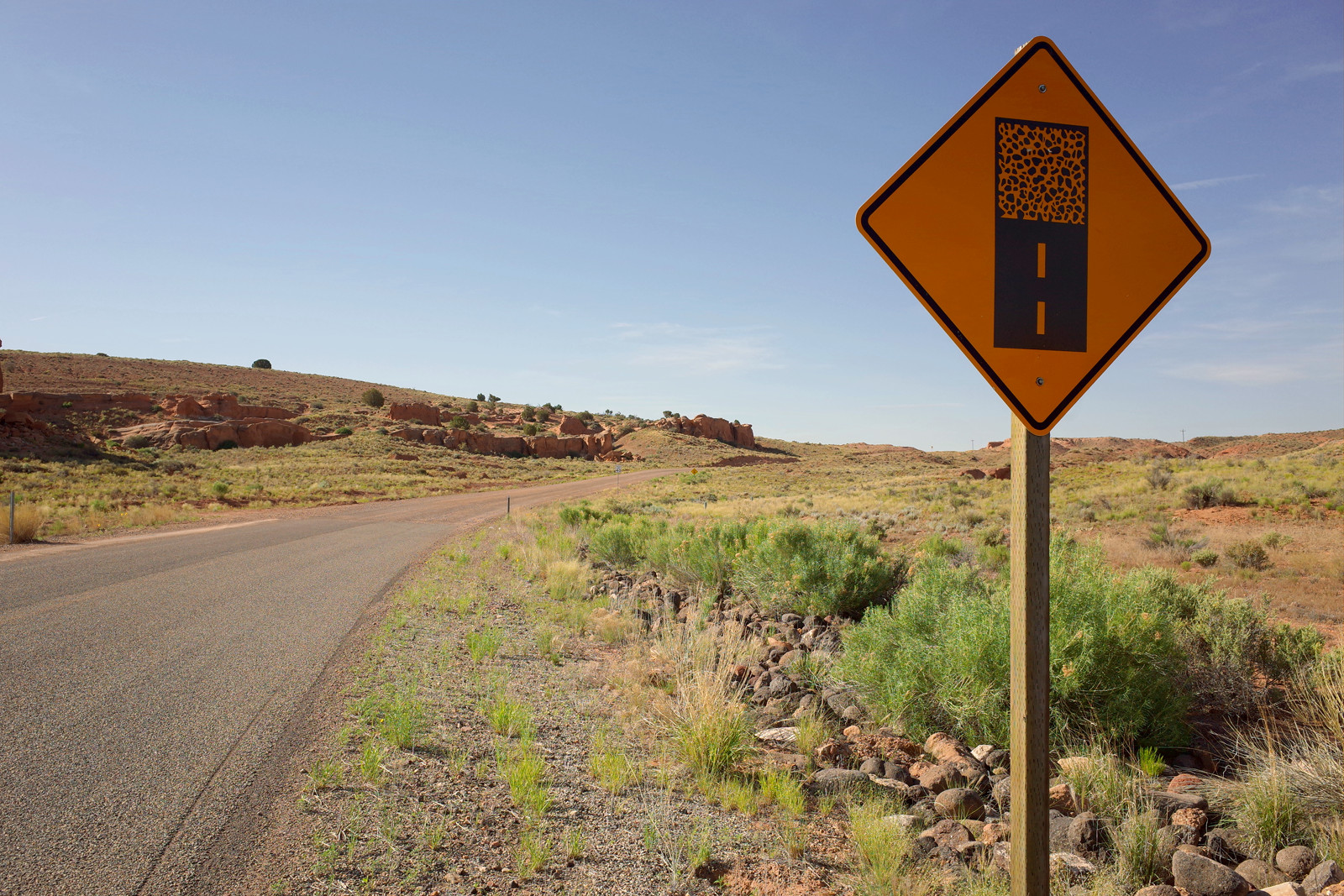 'Pavement ends, dirt road begins' sign along Notom-Bullfrog Road in Capitol Reef National Park
