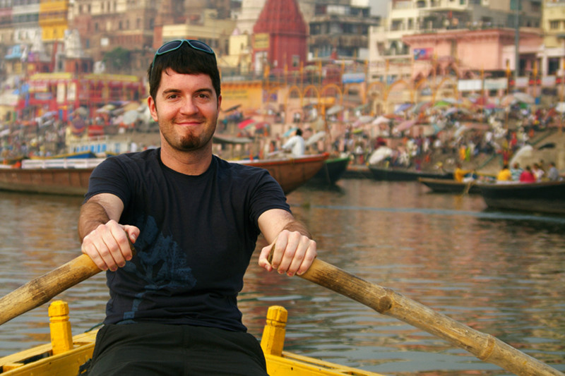 Justin rowing a boat on the Ganges in Varanasi, India