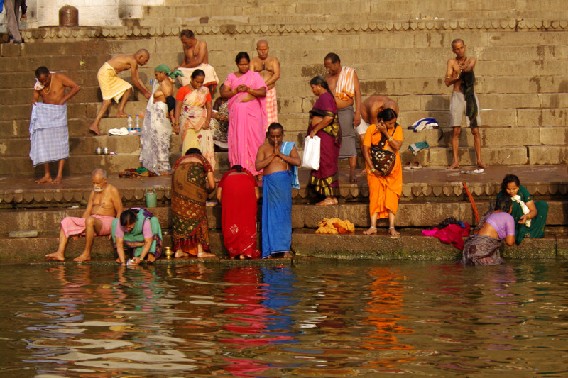 People on the ghats along the Ganges in Varanasi, India