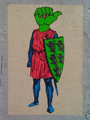 Mysterious wheatpaste at Juniper and Folsom: knight with a thumbs-up head