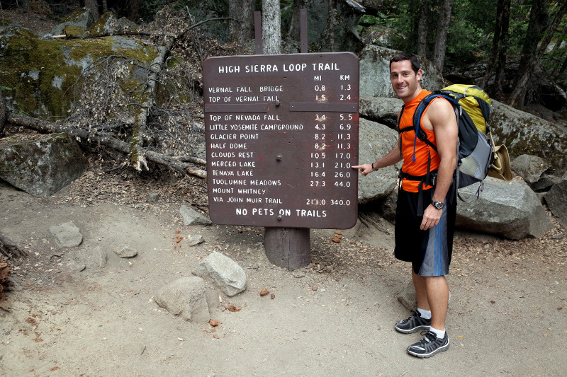 Matthew indicating the mileage to Merced Lake: 13.1 miles
