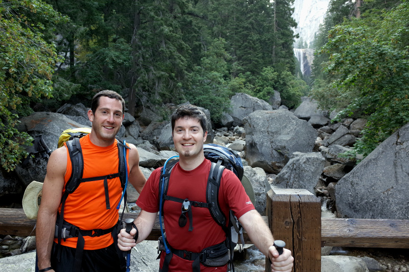 Matthew and Justin on a bridge crossing the Merced River with Vernal Fall in the background