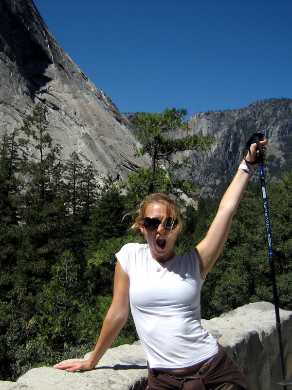 Stephanie celebrates taking a break on the Mist Trail in Yosemite National Park