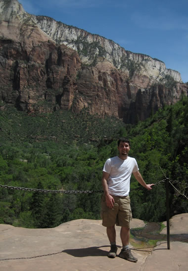 justin at the edge of the middle pool on the emerald pools trails at zion national park
