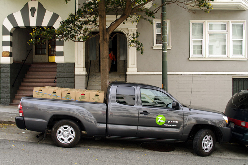 Zipcar pickup truck packed with 30 boxes of our stuff